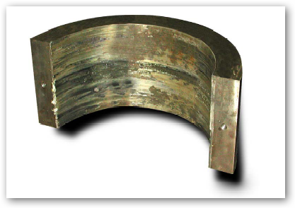 damaged bearing caused by faulty lube oil system